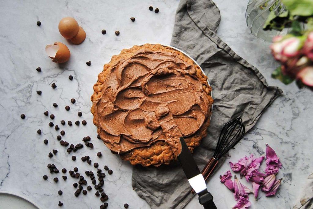 Adding Ganache to Cookie Cake