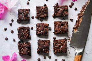 overhead image of one-bowl fudgy chocolate brownies and chocolatey knife