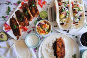 busy display of fish tacos and fixings