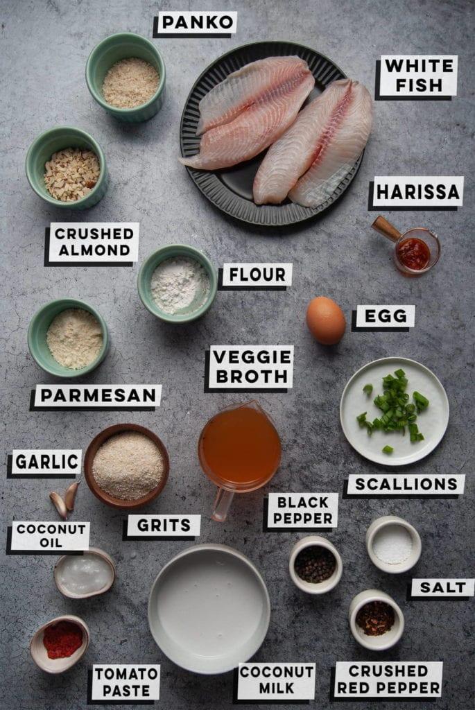 panko, white fish, crushed almond, flour, harissa, egg, parmesan, vegetable broth, scallions, grits, garlic, coconut milk, black pepper, salt, crushed red pepper, coconut oil, tomato paste
