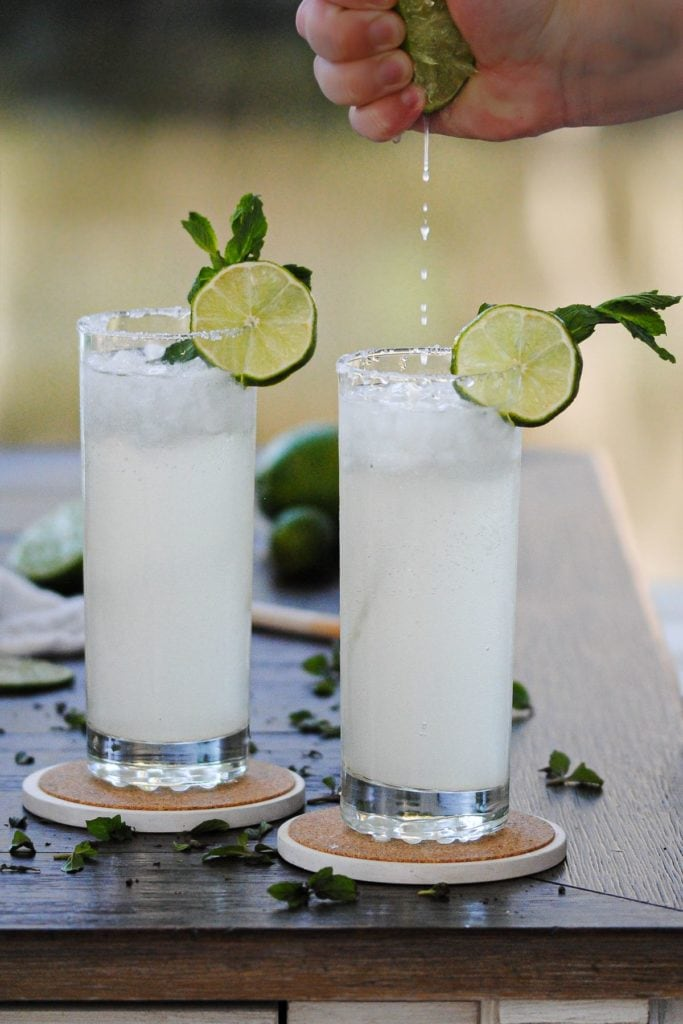 squeezing lime into a ginger beer cocktail