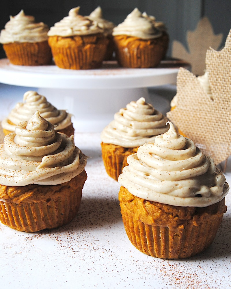 Pumpkin Muffins with Spiced Cream Cheese Frosting - Portrait With Leaf