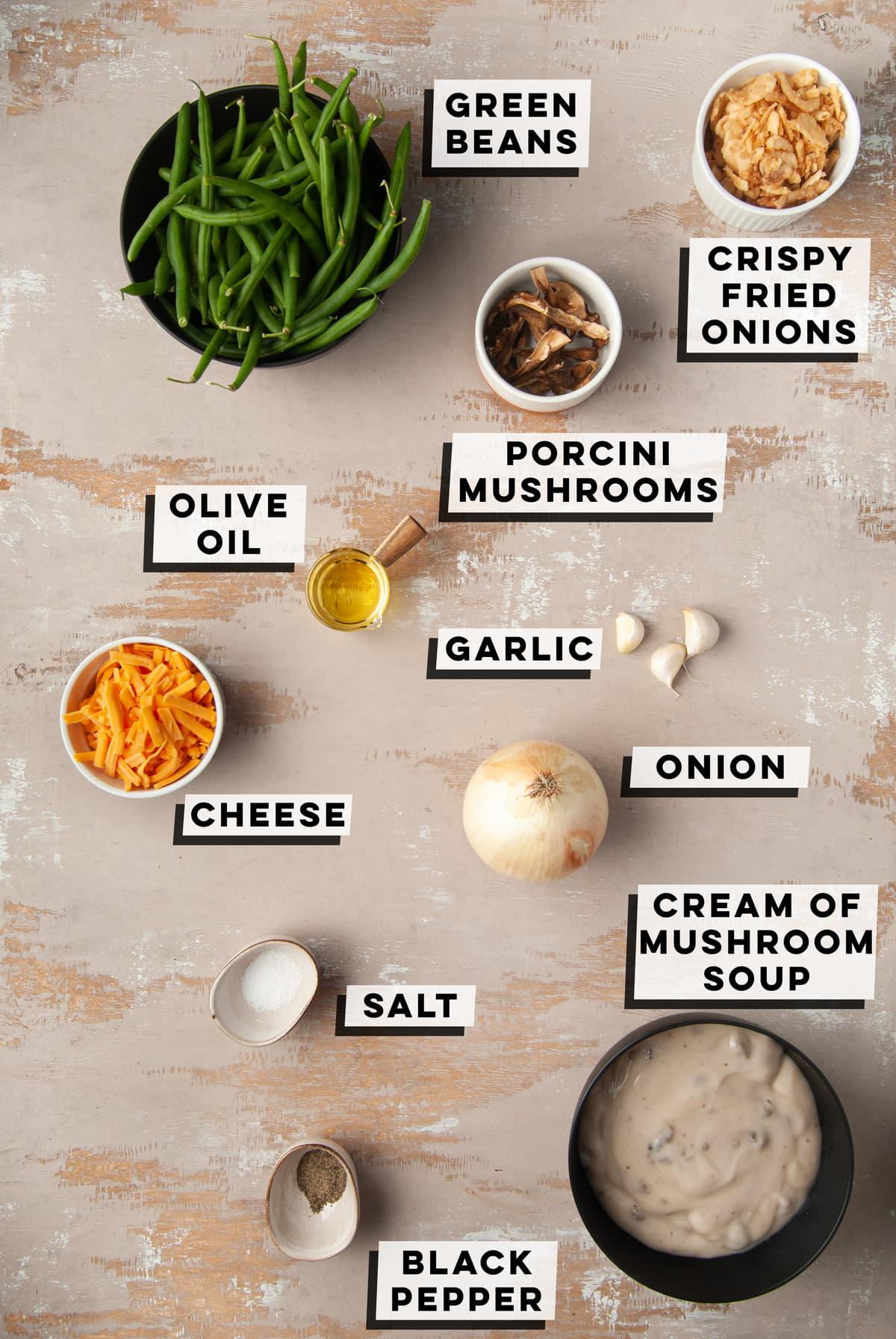 green beans, porcini mushrooms, cheddar cheese, olive oil, garlic, onion, salt, cream of mushroom soup, black pepper