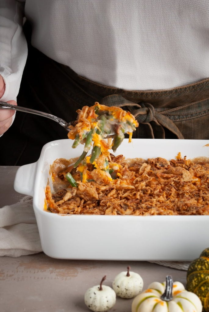 Green Bean Casserole with Secret Ingredient being lifted on a serving spoon