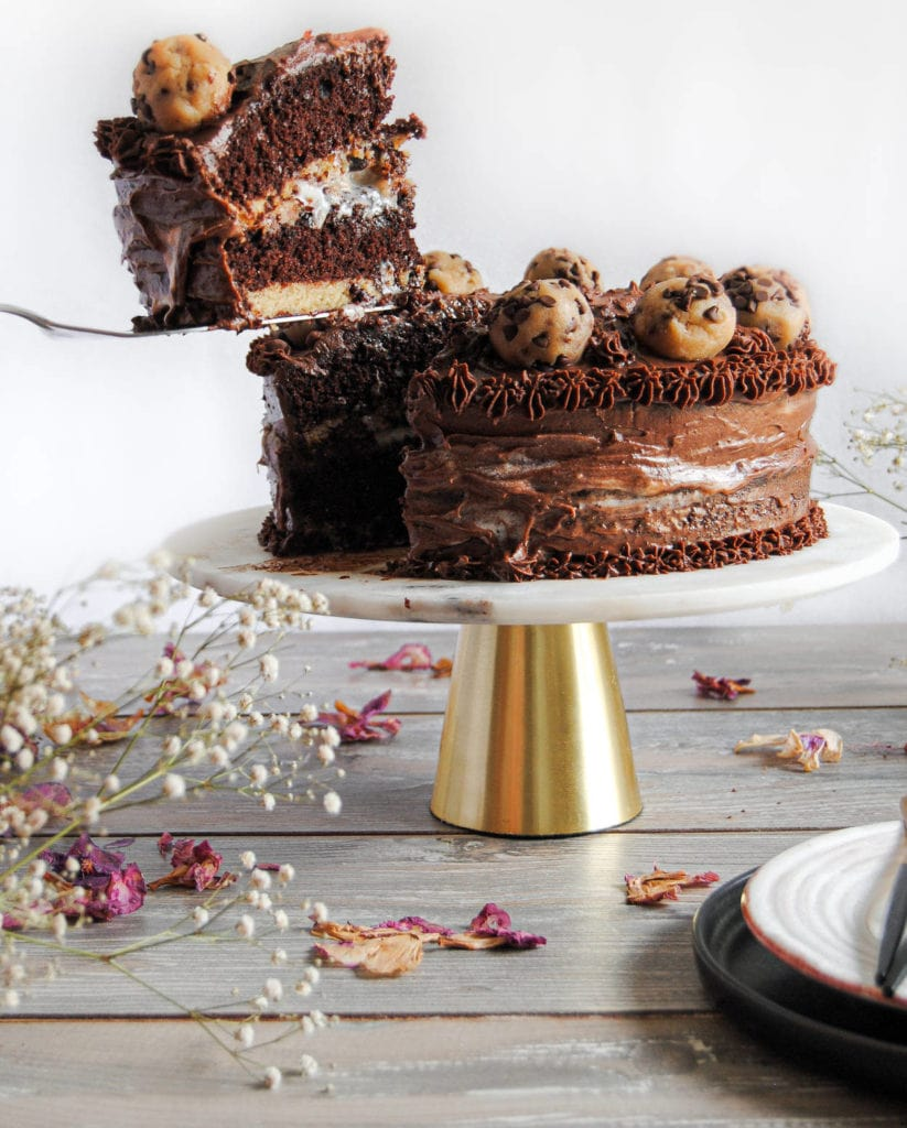 removing slice of chocolate cookie dough cake
