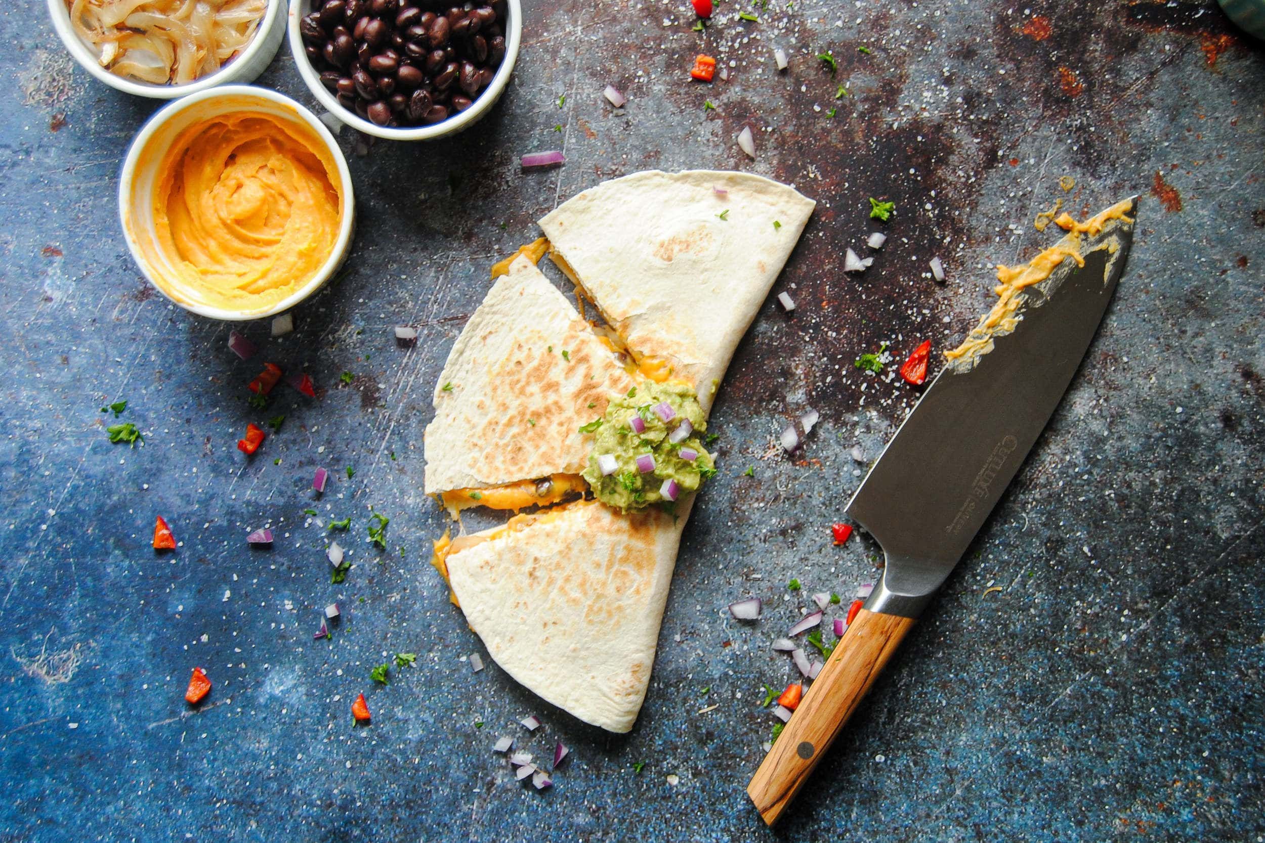 Overhead shot of sweet potato quesadilla with knife