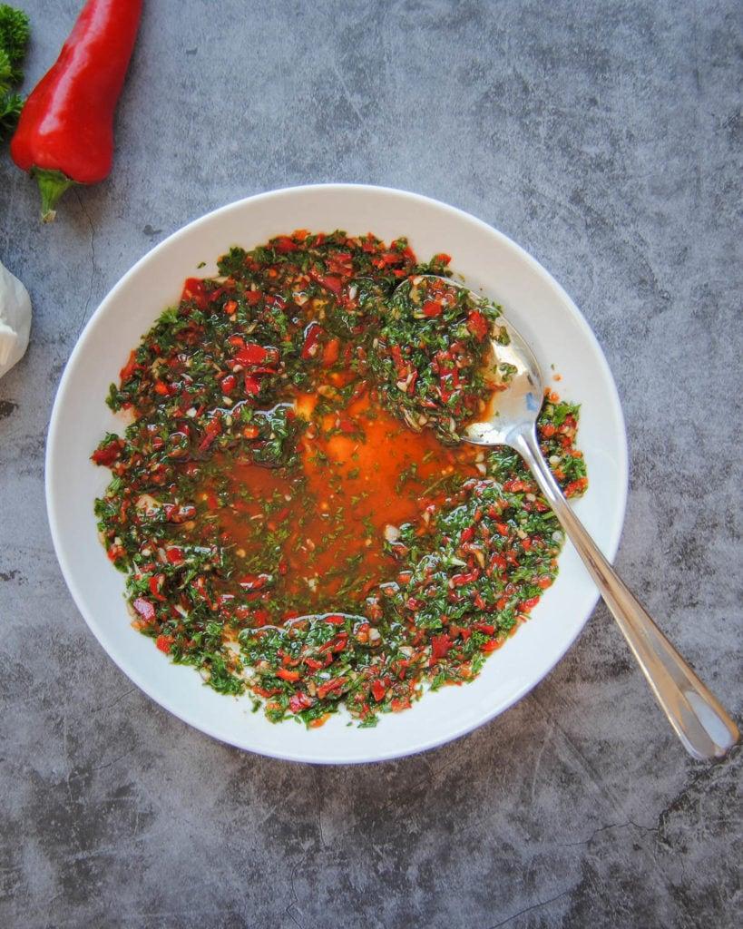 Spicy Serrano Pepper Chimichurri Sauce - Portrait With Spoon