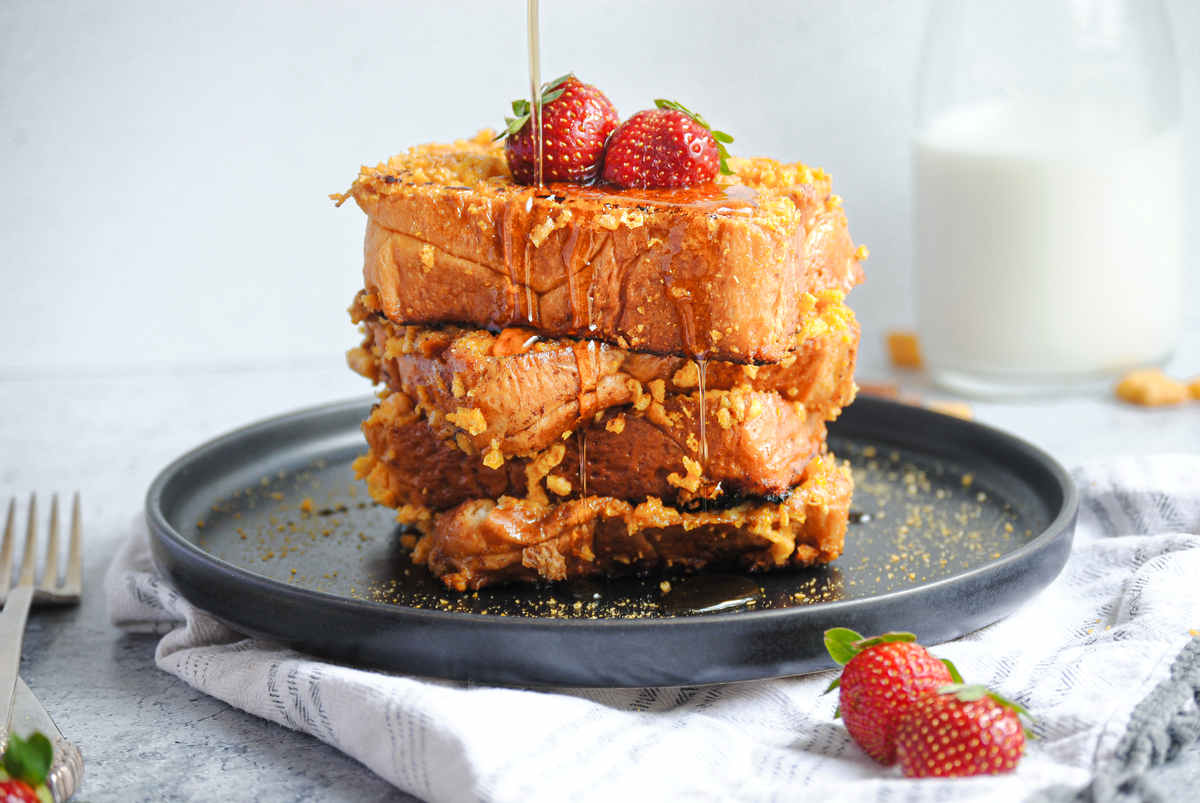 close up of stack of French Toast with syrup dripping down
