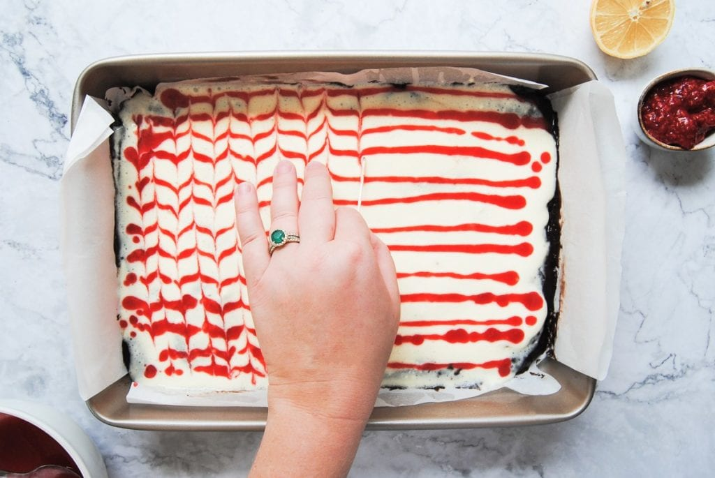 Adding the Raspberry Swirl to the Cheesecake