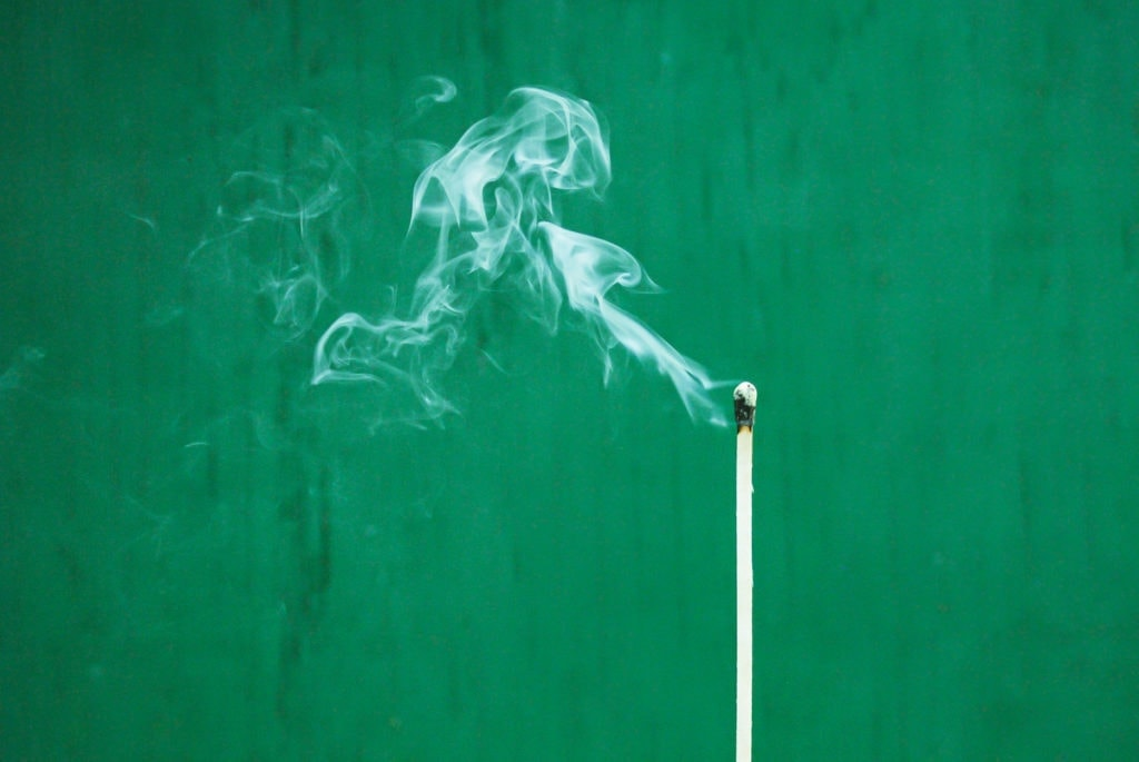 a smoking match to represent the food industry and pollution