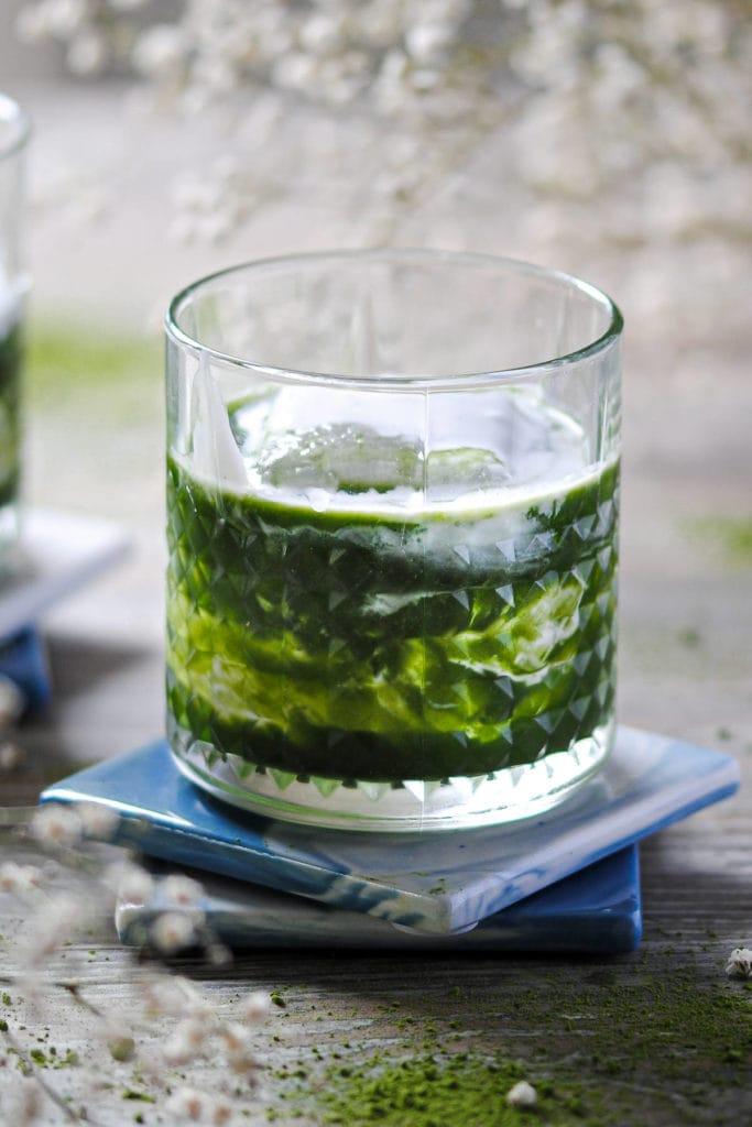cocktail with matcha and cream swirls