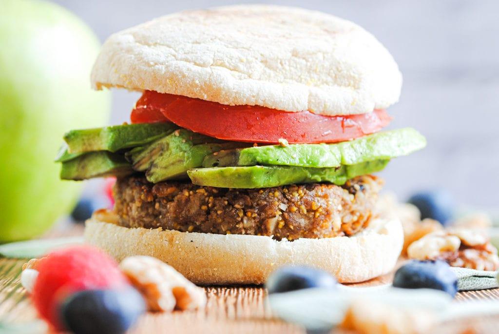 vegan breakfast sandwich with sausage avocado and tomato