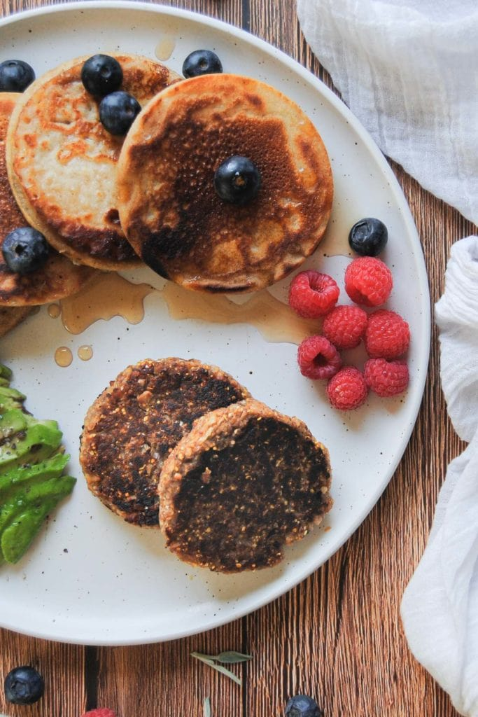breakfast plate with vegan sausage and pancakes and berries