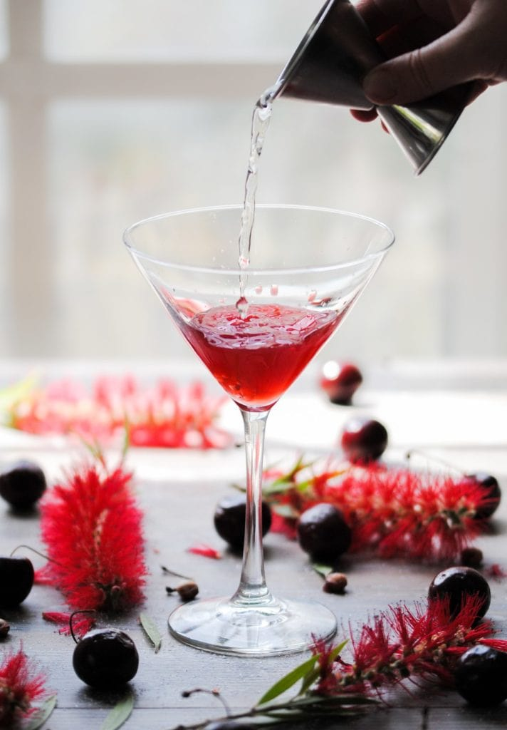 pouring vermouth into cherry martini