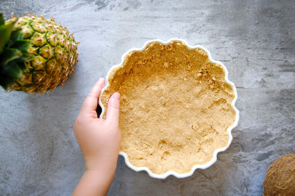 shaping graham cracker crust in pie dish