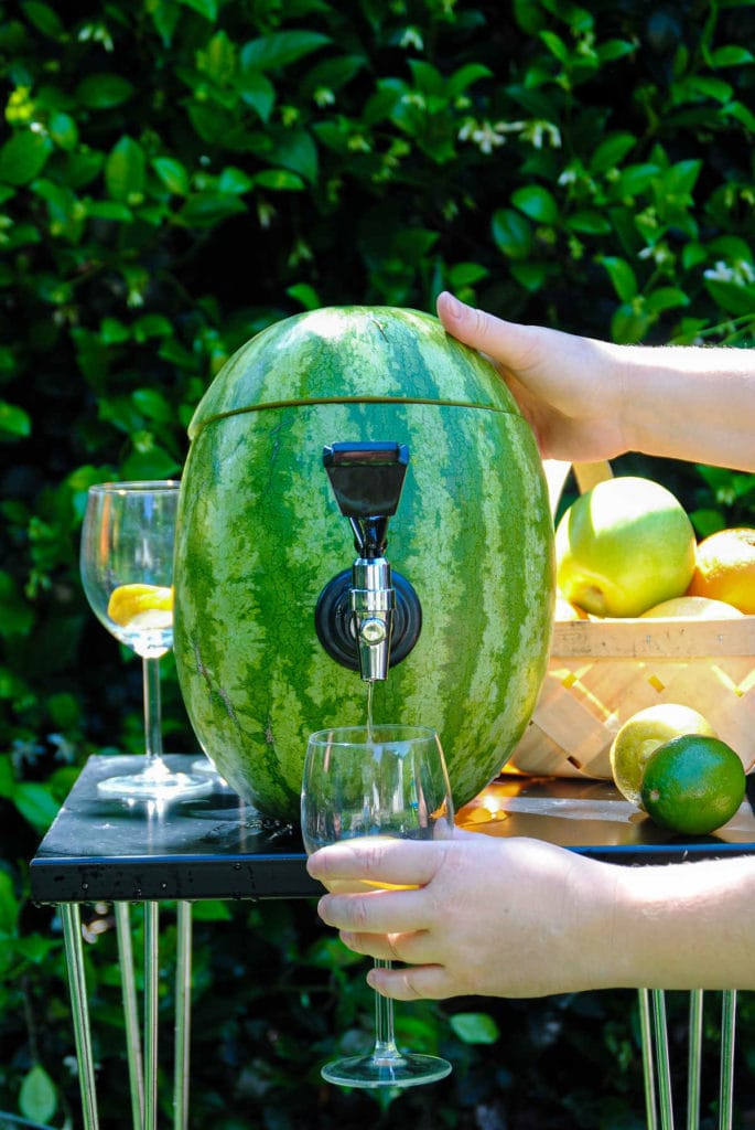 Serving sangria out of a watermelon