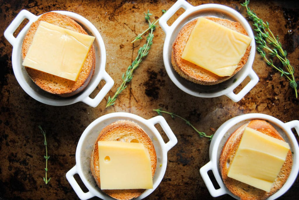 soup with bread and cheese on a baking sheet