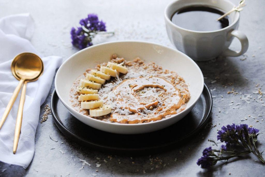 angled shot of breakfast scene with porridge and coffee