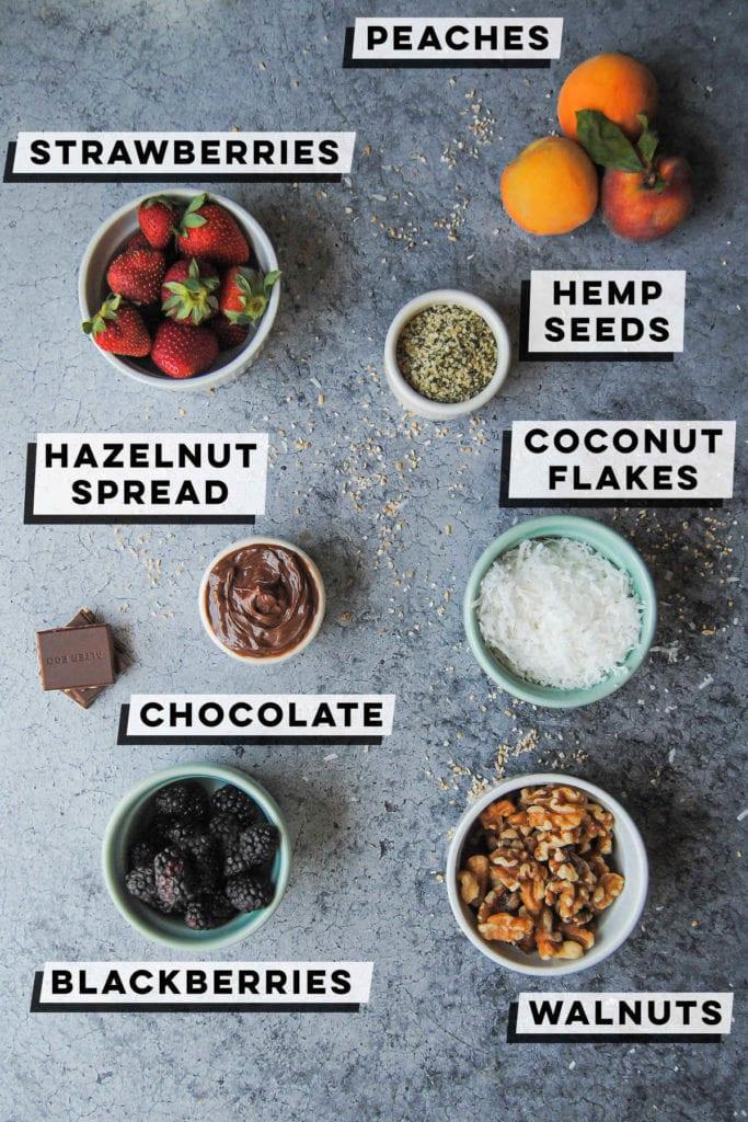 peaches, strawberries, hemp seeds, coconut flakes, hazelnut spread, chocolate, walnuts