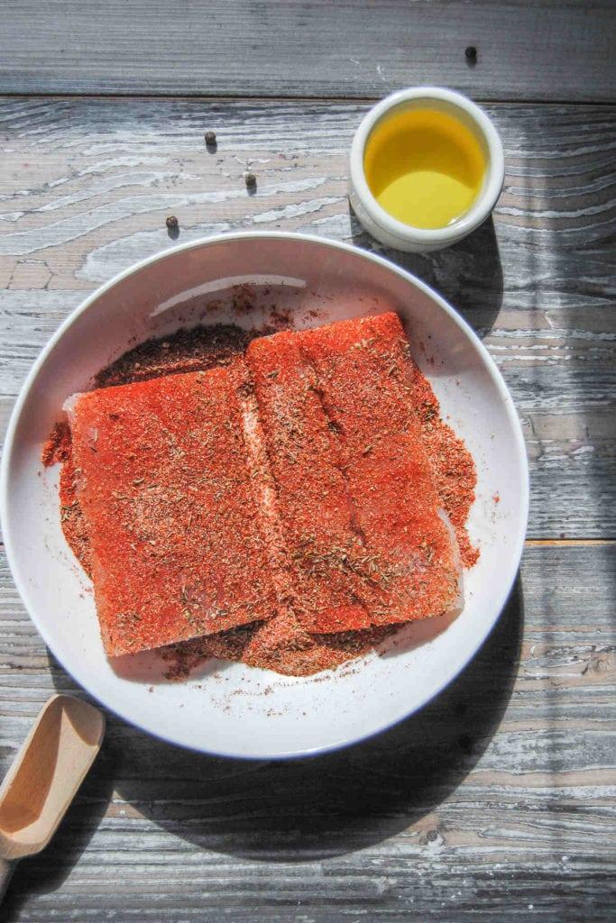 raw fish filets coated in blackening seasoning