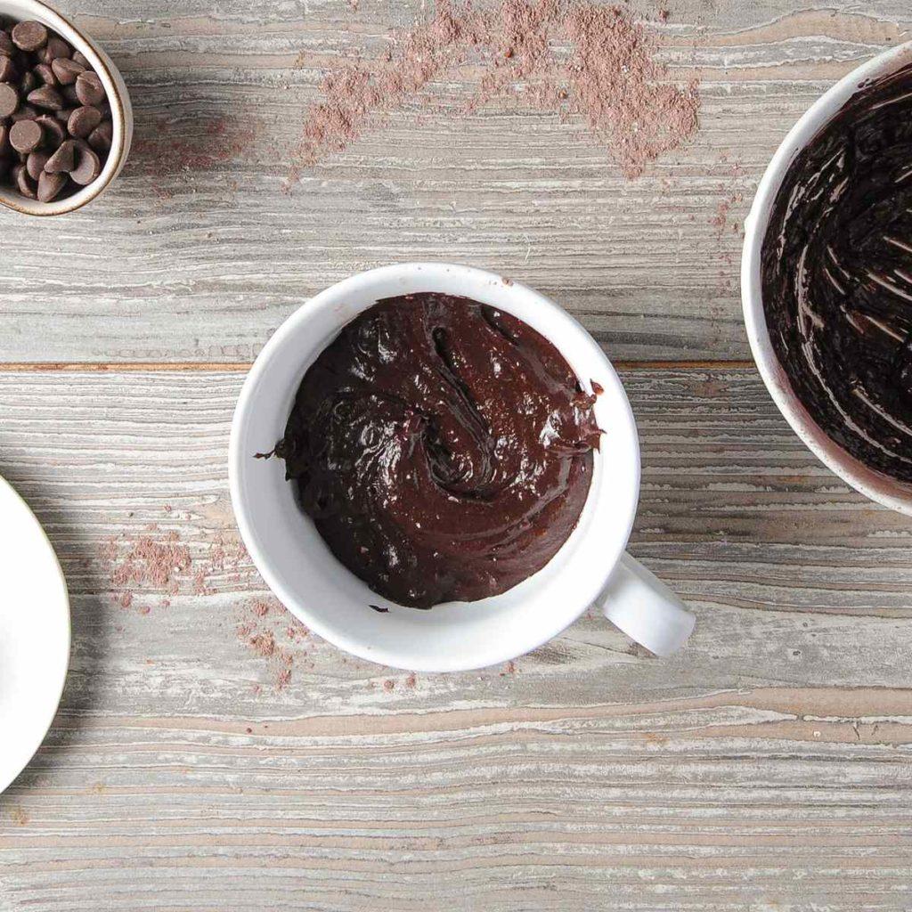 transfering cake ingredients to a mug