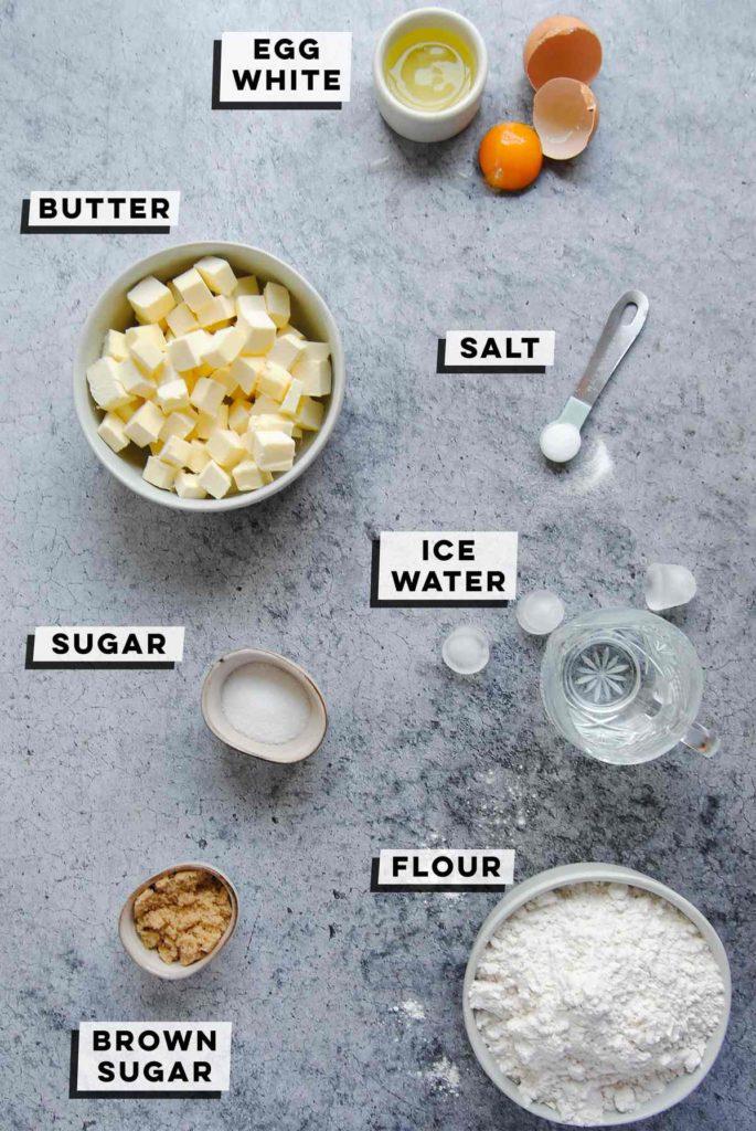 egg white, cubed butter, salt, ice water, brown sugar, granulated sugar, flour