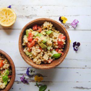 wooden bowl of vegan couscous salad