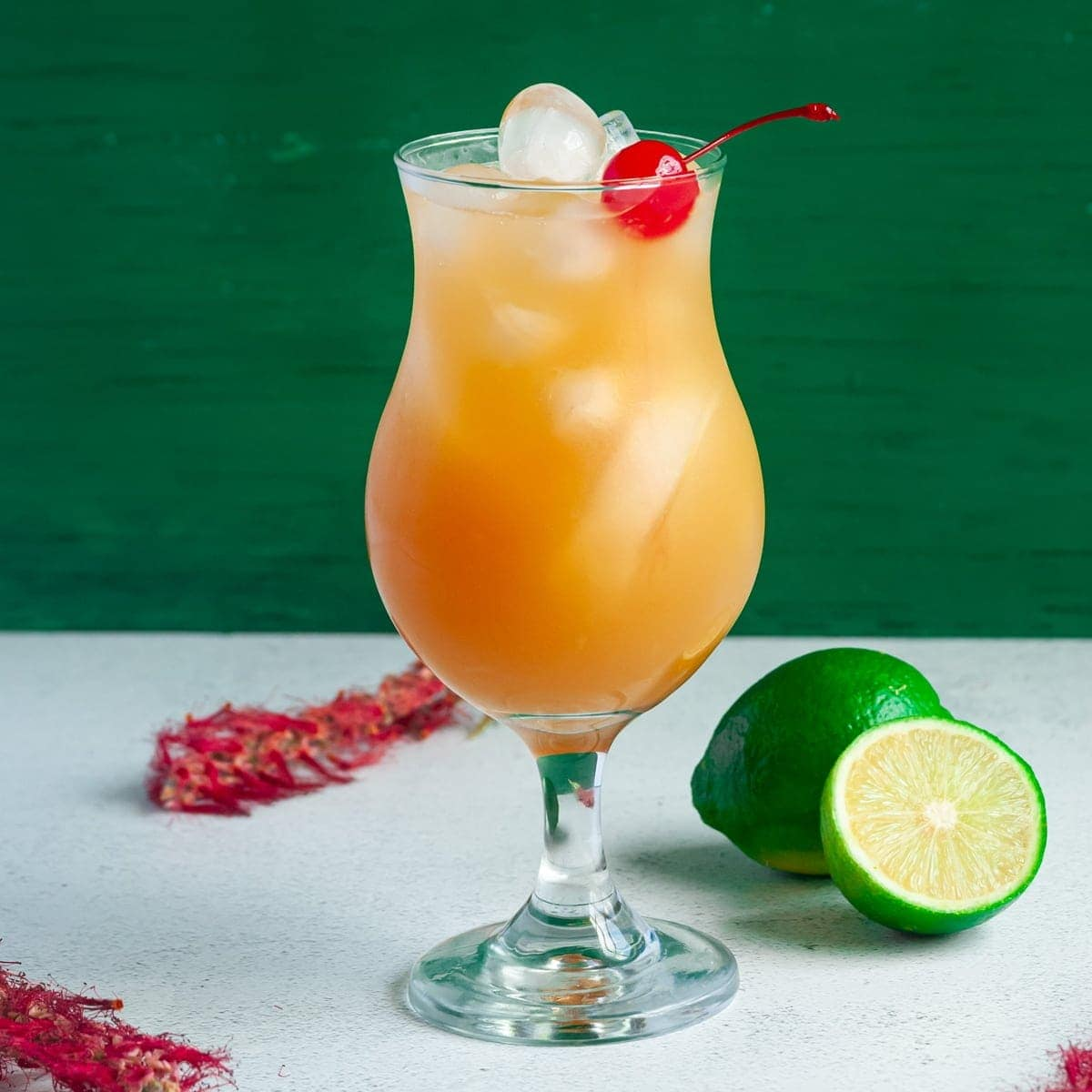 bacardi rum punch in tall glass garnished with cherry