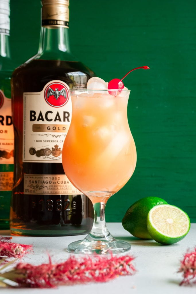 rum punch with bacardi bottles behind it