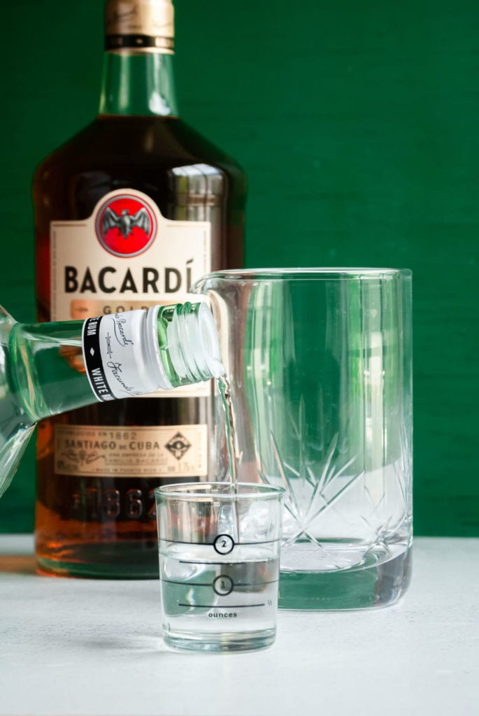 pouring a shot of bacardi rum