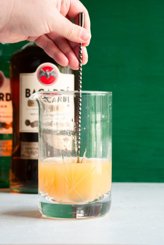 mixing cocktail with long spoon