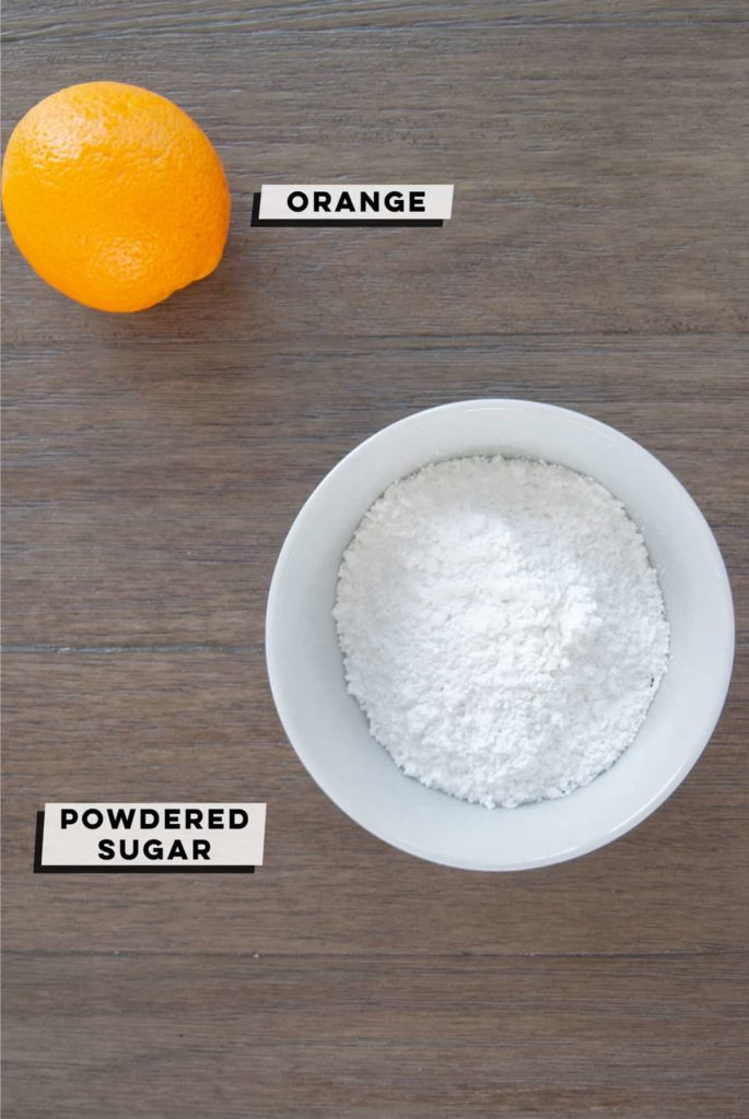 an orange and powdered sugar