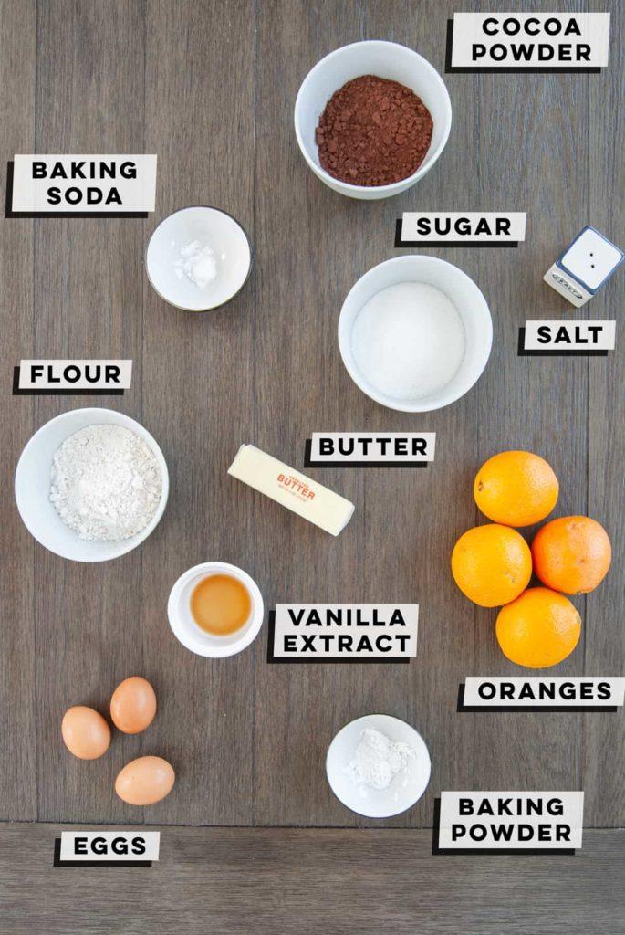 cocoa powder, baking soda, sugar, flour, butter, salt, eggs, vanilla extract, baking powder, oranges