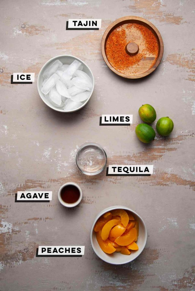 tajin, ice, limes, tequila, agave, and peach slices