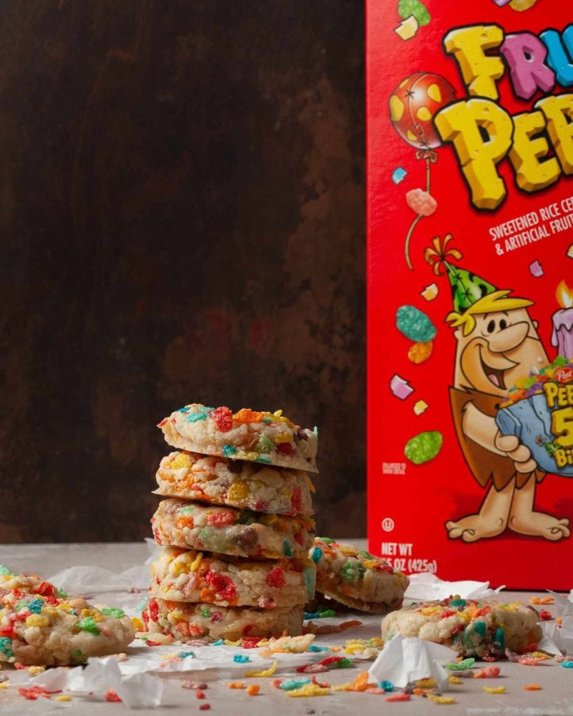 stack of cookies in front of a fruity pebbles box