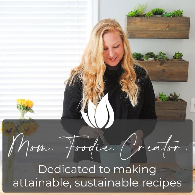 Marley from Marley's Menu mixing ingredients and making notes on a recipe in her kitchen, with a text overlay that reads Mom. Foodie. Creator. Dedicated to making attainable, sustainable recipes