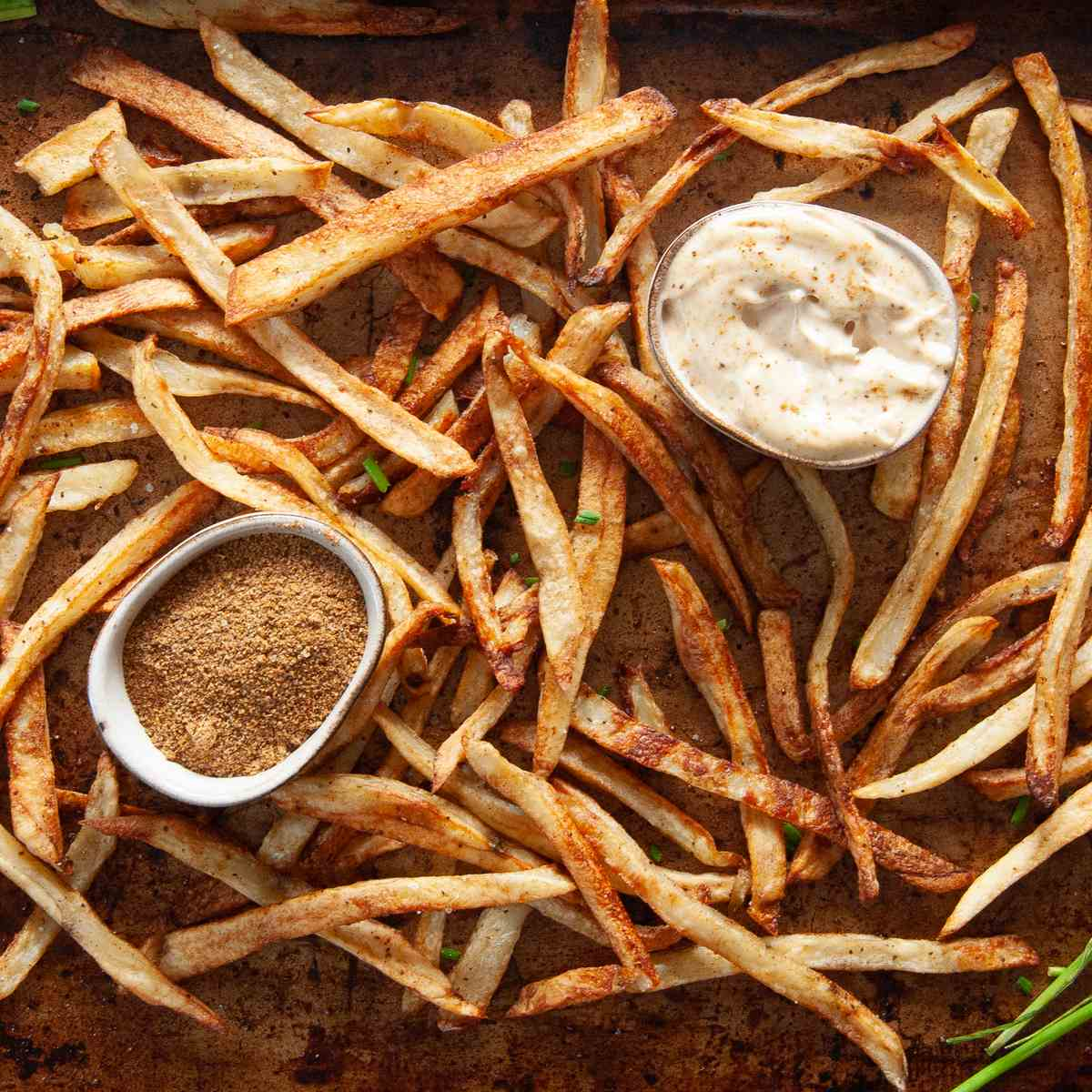old bay fries with quick old bay aioli and bowl of old bay seasoning