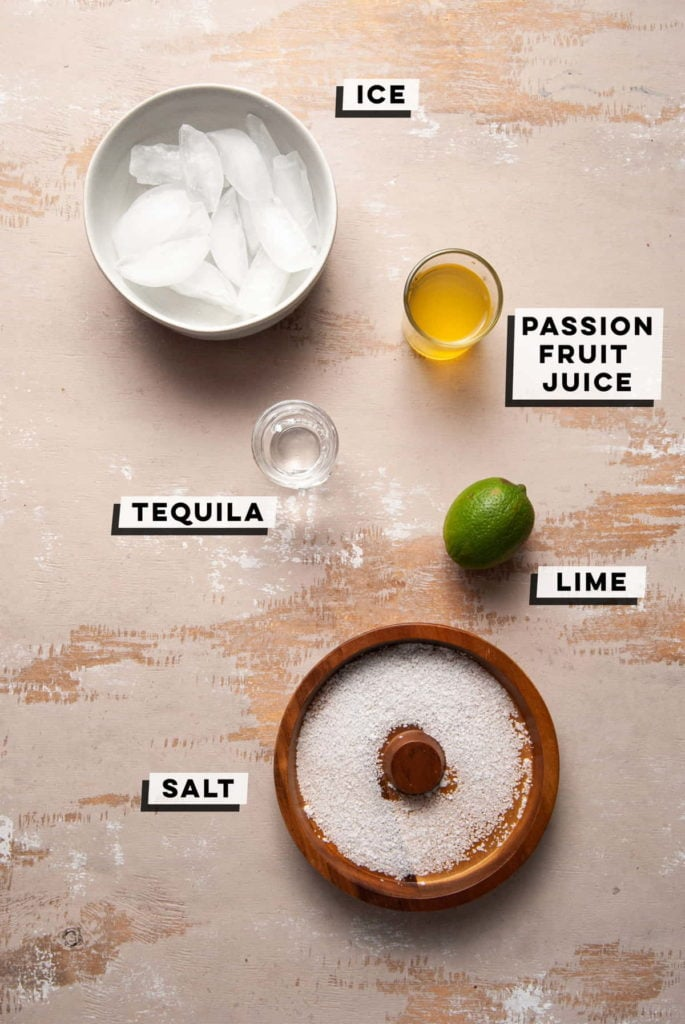 ice, passion fruit juice, tequila, lime, and salt in cocktail rimmer