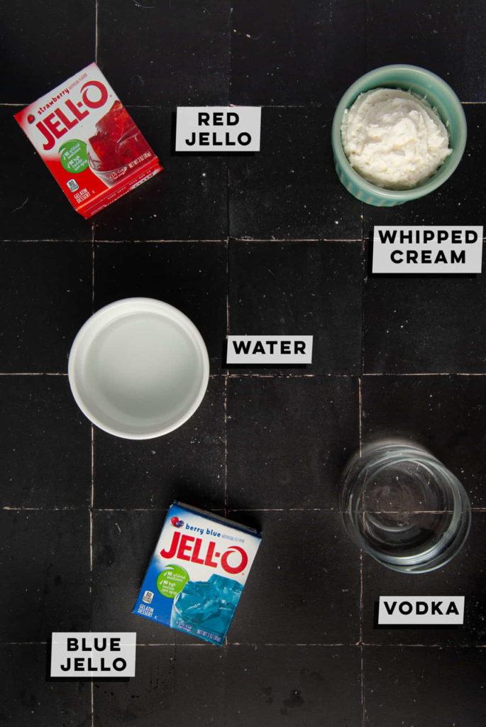 red jello, whipped cream, water, vodka, and blue jello