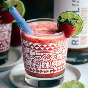 Frozen Strawberry Daiquiri garnished with lime wedge and strawberry wedge