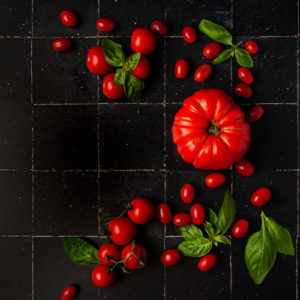 Stylized beefsteak tomato and cherry tomatoes