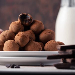 stack of chocolate whiskey truffles on two plates