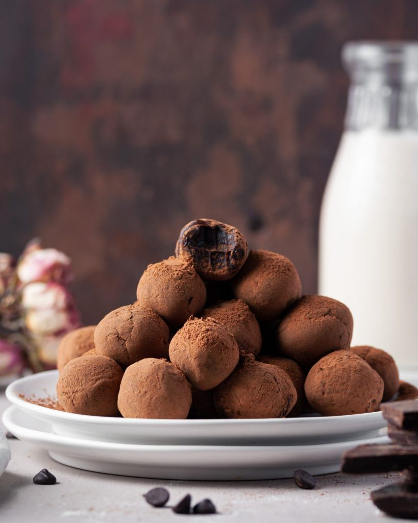 tower of chocolate truffles with one at the top with a bite taken out