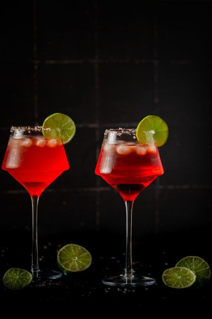 Moody Picture of Two Bright Red Margaritas