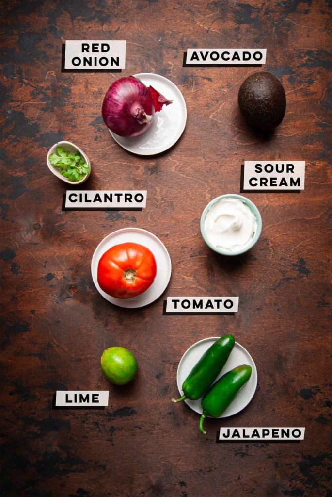 red onion, avocado, cilantro, sour cream, tomato, jalapeno, lime