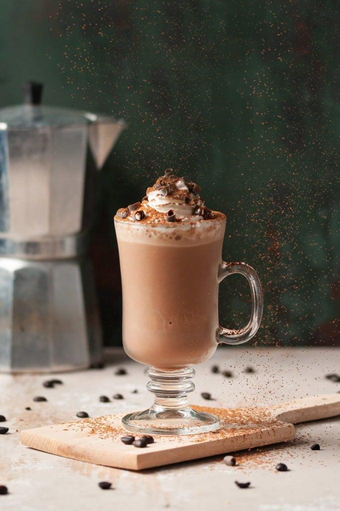 Cocoa Duting on top of milkshake