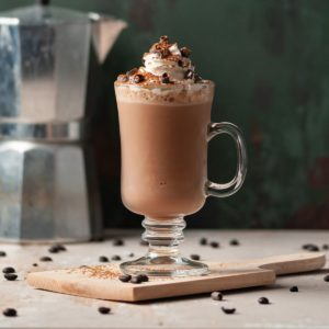 Coffee Milkshake topped with whipped cream and chocolate curls
