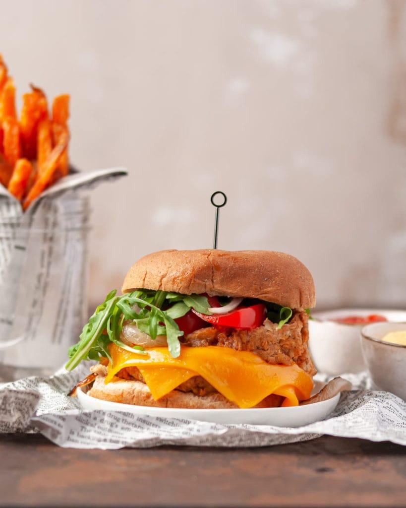 Vegan double cheeseburger with sweet potato fries