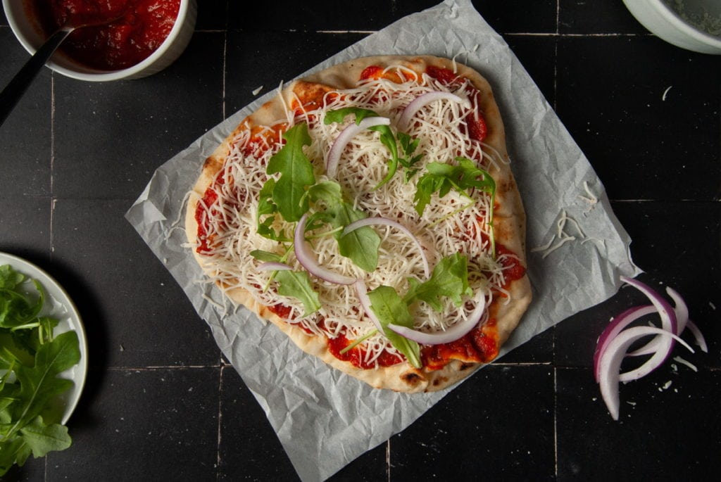 Adding Red Onion and Arugula to Breakfast Pizza