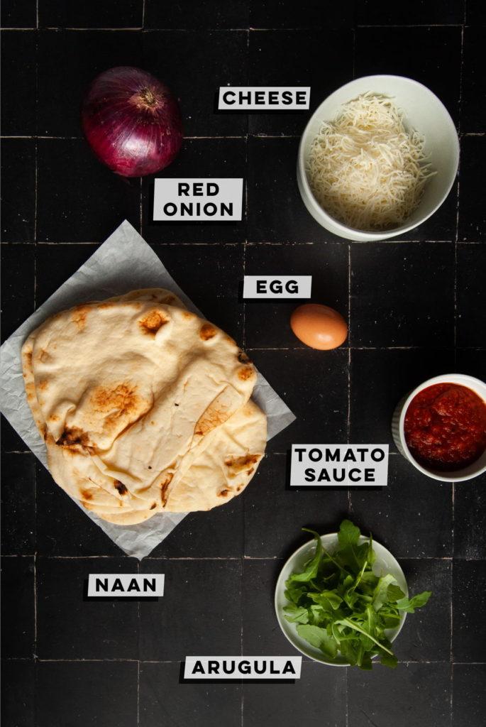 red onion, cheese, egg, naan, tomato sauce, arugula